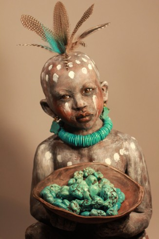 African boy with bowl of turquoise